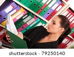 Business woman filling files in the  folders - stock photo
