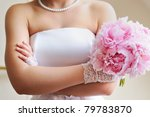 Discontented bride - young woman holding beautiful wedding flowers bouquet (peony) - stock photo
