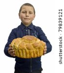 Loaf of  bread in a child's hands - stock photo
