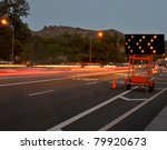 traffic passing by construction/Night Traffic Warning/Night traffic passing by a warning sign - stock photo