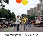 MINNEAPOLIS - JUNE 26:  Unidentified men march in the Twin Cities Gay Pride Parade supporting recent legislation in New York legalizing Gay marriage, on June 26, 2011 in Minneapolis, Minnesota. - stock photo