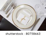 Elegant table set at fine restaurant. Wedding reception. - stock photo