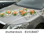 Car with decorations from flower for driving bride and groom during  wedding - stock photo