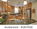 spacious modern kitchen with maple cabinets and granite - stock photo