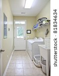 residential laundry room with white appliances - stock photo