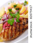 Grilled chicken breast with warm corn and potato salad - stock photo