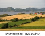 Norwegian farmland by a fjord - stock photo