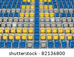 Colored stadium chairs. A field of empty stadium seats. - stock photo