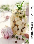 Pickled garlic with spices and herbs - stock photo