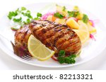 Grilled chicken breast on white plate - stock photo