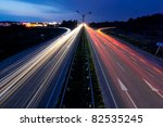 Light trails of evening highway - stock photo