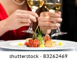 Couple for romantic Dinner or lunch in a gourmet restaurant - stock photo