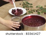 Preserving sour cherries - stock photo