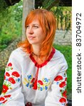 Beautiful Ukrainian girl in national clothes outdoors - stock photo