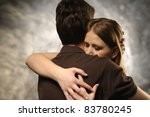 Couple in an embrace on an gray background - stock photo