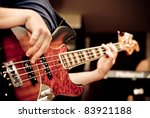 musician playing a bass guitar - stock photo