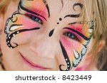 Girl with face painted - stock photo
