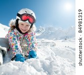 Winter vacation, ski - happy skier playing in snow - stock photo