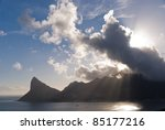Hout Bay with clouds and sun rays - stock photo