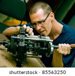 repairing a gearbox - stock photo