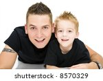 young father laughing with son - stock photo