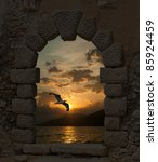 Sunset and seagull through the old castle - stock photo