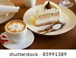 tasty cake at plate closeup with coffee cup - stock photo