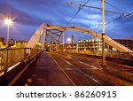 Sheffield Tram Bridge and lines by night - stock photo