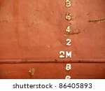 Closeup view of the waterline of a freighter ship anchored in port - stock photo