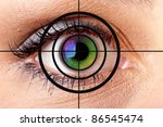 Close-up of colorful human eye and target - stock photo