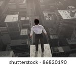 Businessman standing on the skyscraper top - stock photo