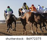 Closeup of racing horses starting a race - stock photo
