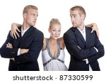 young woman in dress standing between two men in suits - isolated on white - stock photo