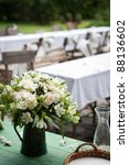 Countryside wedding reception: close-up of the wedding bouquet - stock photo