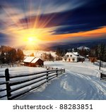 Winter landscape. Mountain village in the Ukrainian Carpathians. - stock photo