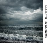 dark storm clouds and waves on the sea - stock photo