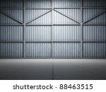 Large warehouse door illuminate spotlight - stock photo