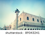 Sculpture of the winged lion, the Doges Palace and the St Mark's Basilica at St Mark`s Square in Venice. - stock photo
