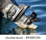 outboard engine propeller on the sea - stock photo