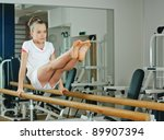 portrait of young beauty gymnast in gymnasium - stock photo