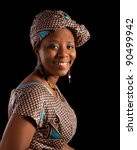 Portrait of a young ghanese woman in traditional african dress - stock photo