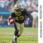 CHARLOTTE, NC - OCT 09, 2011:  Saints Running Back, Darren Sproles, runs for yardage against the Carolina Panthers at the Bank of America Stadium in Charlotte, NC on Oct 9, 2011. - stock photo
