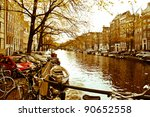 a beautiful Amsterdam picture with canal, boats and architecture - stock photo