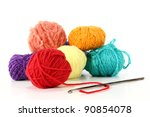 colorful balls of wool with crochet hook on a white background - stock photo