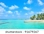 Maldives island and cloudy sky - stock photo