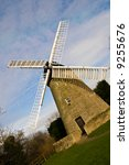 Imposing view of a traditional stone windmill - stock photo