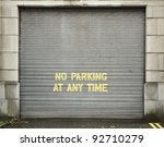 "Door with text ""no parking at any time"" - stock photo"