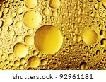 macro of oil drops on the water - stock photo