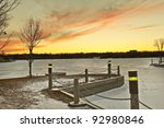 Wascana lake frozen on a cold November day during winter in Regina, Canada. - stock photo