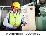 male occupational health and safety officer inside factory doing inspection - stock photo